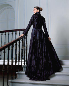 Vera Mont Collection - This fabulous black taffeta coat left has a detachable train made of a sea of frayed ribbons. The matching evening dress beneath also has a small train.
